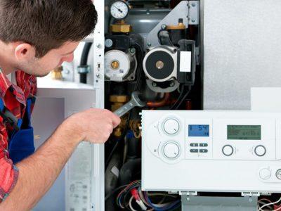 Man checking boiler